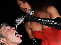 Mistress Carly isn't happy with how much spunk her submissive has been producing lately so she is punishing him with a special drink.