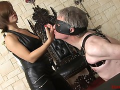 Wearing my long, leather loves, I demand that my slave kiss my hands as he kneels before me blindfolded. After smacking him in the face a few times I