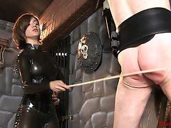 With my slave secured to the wall again I give him a lesson in speaking Russian. I tell him how to say various Russian words and when he fails to impr